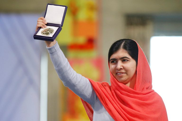 Nobel Peace Prize laureate Malala Yousafzai poses with her medal during the Nobel Peace Prize awards ceremony at the City Hall in Oslo December 10, 2014. Pakistani teenager Malala Yousafzai, shot by the Taliban for refusing to quit school, and Indian activist Kailash Satyarthi received their Nobel Peace Prizes on Wednesday after two days of celebration honouring their work for children's rights. REUTERS/Cornelius Poppe/NTB Scanpix/Pool   (NORWAY  - Tags: SOCIETY CIVIL UNREST TPX IMAGES OF THE DAY) NORWAY OUT. NO COMMERCIAL OR EDITORIAL SALES IN NORWAY.